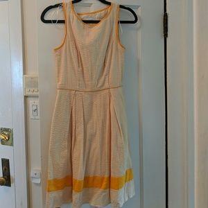 Orange and white seersucker dress
